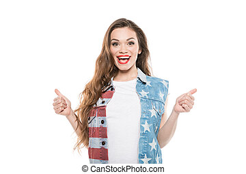 smiling american style girl showing thumbs up isolated on white
