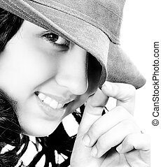 Smiling And Cheeky Young Girl Wearing A Hat
