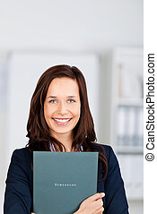Smiling applicant - Portrait of smiling applicant holding...