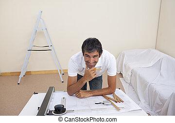 Smiling architect man refurbishing a bedroom - Smiling...
