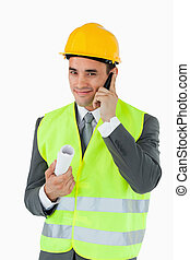Smiling architect on the phone