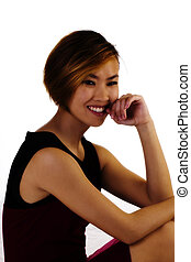 Smiling Asian American Woman In Dress Sitting