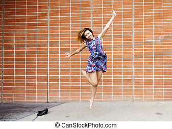 Smiling Asian American Woman Jumping In Dress