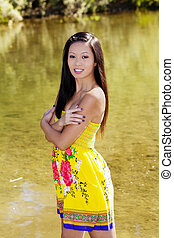 Smiling Asian American Woman Outdoor Water Background