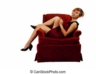 Smiling Asian American Woman Sitting In Red Dress