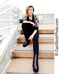 Smiling Asian American Woman Sitting On Steps