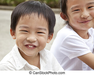smiling asian boy and girl