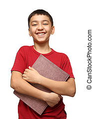 smiling asian boy holding big book