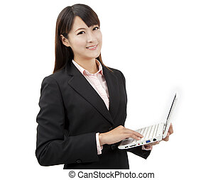 smiling asian business woman holding laptop