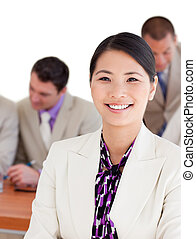 Smiling Asian businesswoman in a meeting