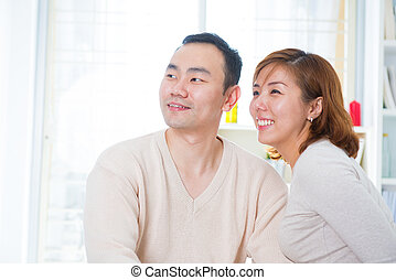 Asian couple looking away - Smiling Asian couple looking...