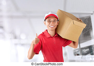 Smiling asian courier man with red uniform delivering parcel