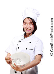 smiling asian female chef  with whisk and bowl
