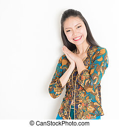 Smiling Asian female