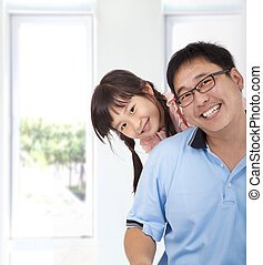 smiling asian girl and father
