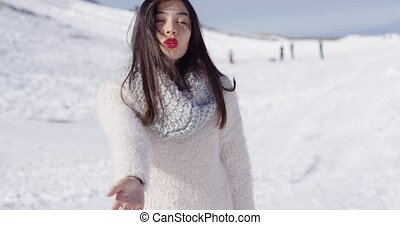 Smiling asian girl in woolen sweater relaxing