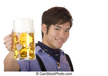 Smiling Asian holding Oktoberfest beer stein (Mass) - Asian...