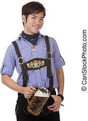 Smiling Asian holding Oktoberfest beer stein (Mass)