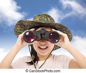 smiling asian Little girl looking through binoculars