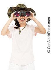 smiling asian Little girl looking through binoculars.