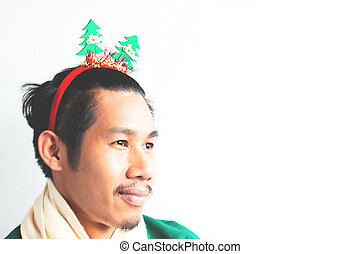 Smiling asian man in Christmas theme clothing on white background