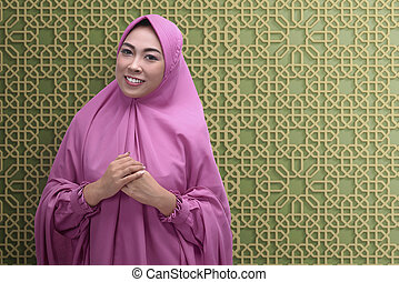 Smiling asian muslim woman with hijab