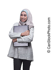 Smiling asian muslim woman with laptop