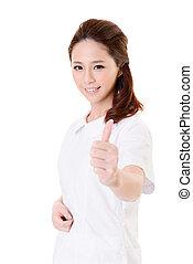 excellent - Smiling Asian nurse give an excellent sign,...