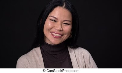 Smiling Asian sends an air kiss - Happy Asian Woman Is...