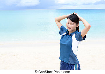 Smiling Asian woman on the beach