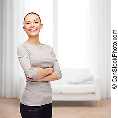 smiling asian woman over with crossed arms