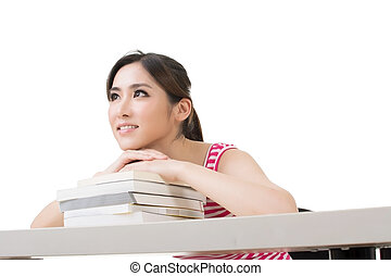 Smiling Asian woman with books