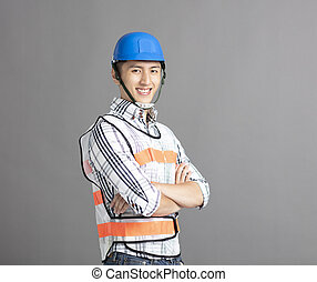 smiling asian young man construction worker