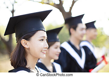 smiling asian young woman at graduation