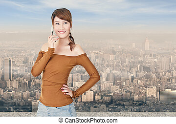 Smiling Asian young woman use cellphone