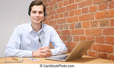Smiling assistant using a headset in a call center , online customer service