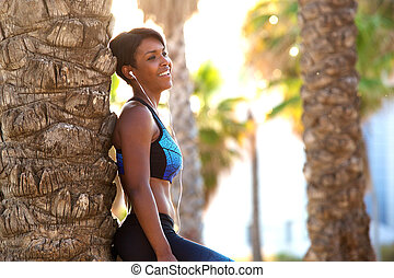 Smiling attractive african american sporty woman