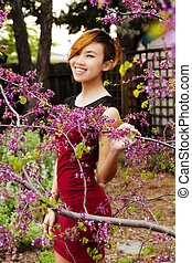 Smiling Attractive Asian American Woman Standing Outdoors