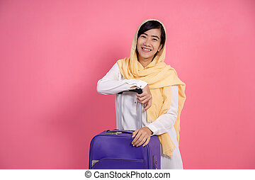 smiling attractive asian muslim woman with scarf looking at camera