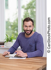 Smiling attractive man working at home