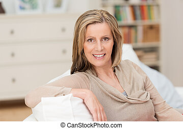 Smiling attractive woman in her living room