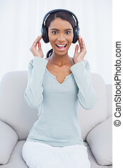 Smiling attractive woman listening to music