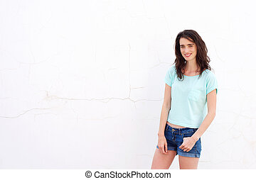 Smiling attractive woman standing against white background