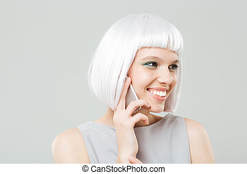 Smiling attractive young woman talking on cell phone
