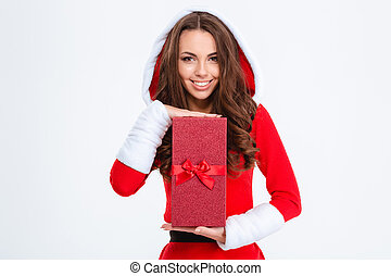 Smiling attractivewoman in santa claus costume posing with present