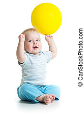 Smiling baby boy  with yellow ballon in his hand isolated on white