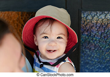 Smiling baby girl in hat