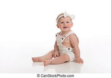Smiling Baby Girl Wearing White Overalls