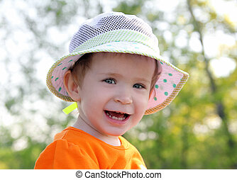 smiling baby in hat outdoor
