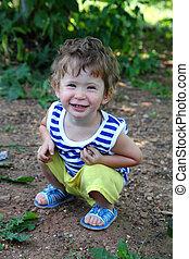 smiling baby in summer garden